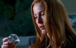 scully with snow globe.png